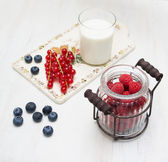 Bilberry currant raspberry vintage ware on a wooden board — Stock Photo