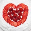 Heart from strawberry whipped cream on a plate — Stock Photo #38946845