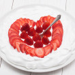 Heart from strawberry whipped cream on a plate — Stock Photo #38946859