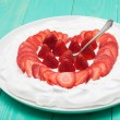 Heart from strawberry whipped cream on a plate — Stock Photo