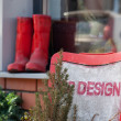Boots red on a window sill design a vintage chair — Stock Photo