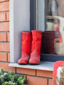 Boots red on a window sill design a vintage — Stock Photo