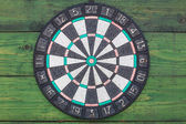 Darts, on a wall from green boards — Stock Photo