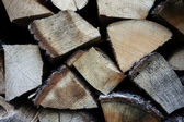 Piled fire wood chunks — Stock Photo