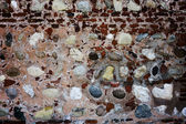 Many colored stones embedded in a wall — Stock Photo