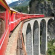 The train of Bernina Express on the Swiss alps — Stock Photo