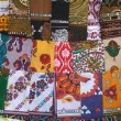 African textile cloths on the market of Mayotte island - Stock Photo