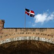 Colonial building and national flag at Santo Domingo — Stock Photo #16343821