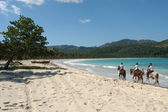 Horse ride on the beach of Playa Rincon — Stock Photo