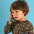 Child talking with a mobile phone — Stock Photo