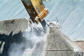 Demolition of a wall with a pneumatic hammer — Stock Photo
