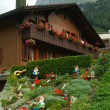 Garden gnomes at Traditional wooden Swiss house — Stock Photo