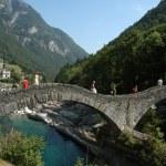 Roman bridge over River Verzasca on Verzasca valley — Stock Photo #17695911