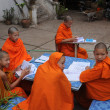 Little Buddhist monks learning in a monastery school - Stock Photo
