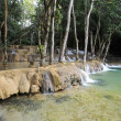 Waterfall in the rainforest near Luang Prabang in Laos — Stock Photo