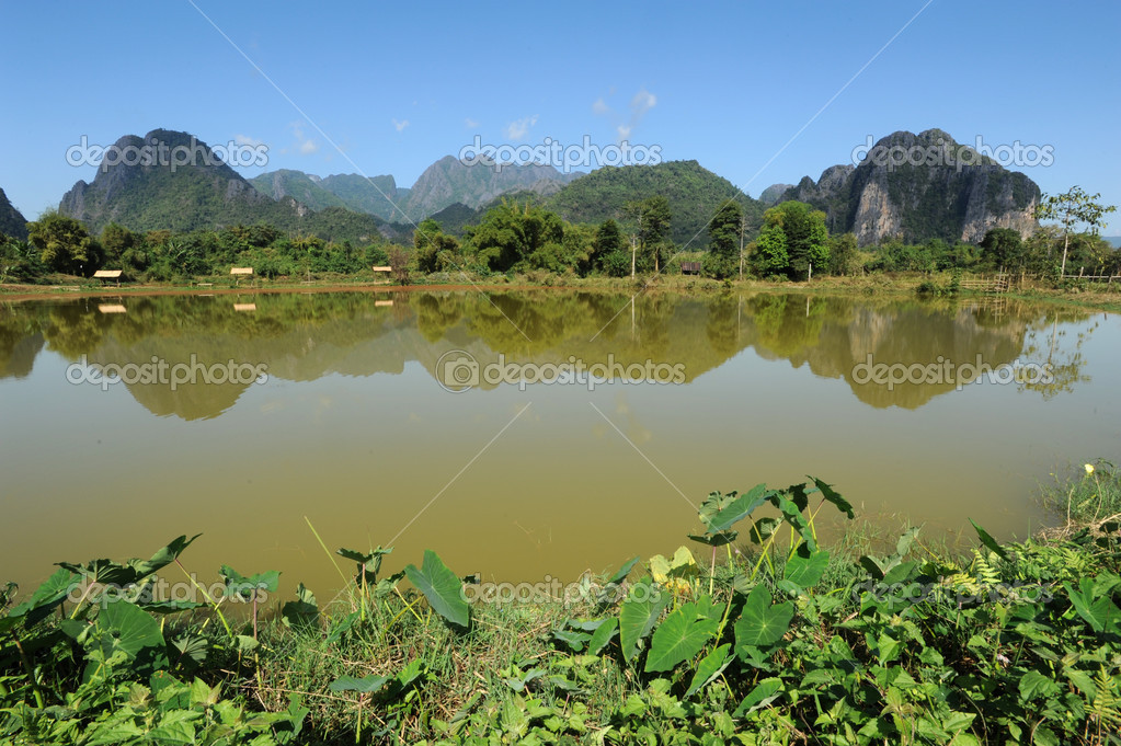 Rural landscape near Vang Vieng on Laos — Stock Photo #18515991