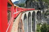 Bernina Express train on the Swiss alps — Stock Photo