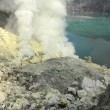 Sulphatic lake in a crater of volcano Ijen. Java. Indonesia — Stock Photo #27558545