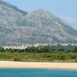 The beach of the village of Marina di Orosei on the island of Sardinia, Italy — Stock Photo #30283857