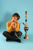 Young boy smoking hookah — Stock Photo