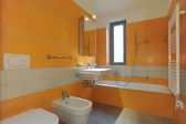 Orange bathroom interior — Stock Photo