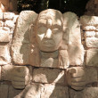 Stone face bas-relief — Stock Photo #43693663