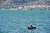 Fisherman with canoe — Stock Photo