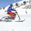 Man on snowmobile in the Swiss alps — Stock Photo #47609241