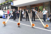 Music with alphorn at Engelberg on the Swiss alps — Stock Photo