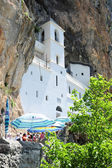 Believers lined up for the visit of the Ostrog monastery near Da — Stock Photo