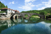 The old arched stone bridge of Rijeka Crnojevica — Stock Photo