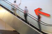 People on a escalator — Stock Photo