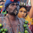 A devotee with cigar and lime kavadi. - Stock Photo