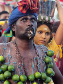 A devotee with cigar and lime kavadi. — Stock Photo
