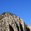 Cliff against blue sky — Stock Photo #18344597