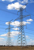 Electrical transmission towers — Stockfoto