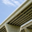 Stock Photo: Underside of highway bridges on blue sky