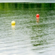 Buoy markers on lake — Stock Photo
