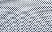 Frozen small chain-link fence pattern. — Stock Photo