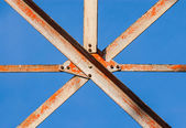 Metal girders crossing with screws. — Stock Photo
