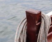 Coiled rope hung on wooden post. — Stock Photo