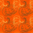 Royalty-Free Stock Vector: Seamless halloween pattern with pumpkins