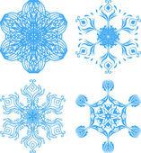 Samling av fyra elegans snöflingor — Stockvektor