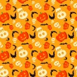 Vector funny halloween pattern with skulls, bats and pumpkins — Stock vektor