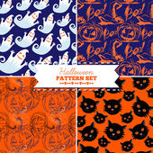 Set of four Halloween vector patterns — Stock Vector