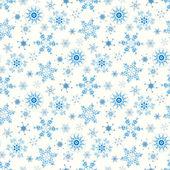 Patrón de navidad con copos de nieve — Vector de stock