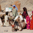 Bedouins with their camels — Stock Photo