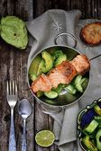 Grilled salmon with avocado and cucumber salad — Stock Photo
