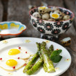 Asparagus and fried quail eggs - Stock Photo