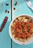 Pasta with tomato sause and beans — Stock Photo